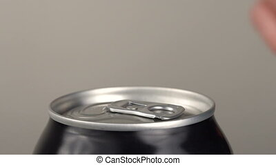 The girl opens a beer can. Slow motion. Close-up