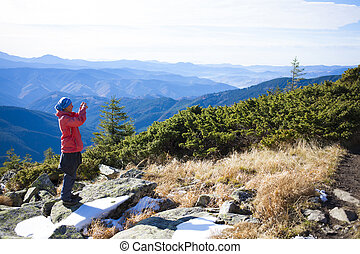 The girl photographer in the mountains.