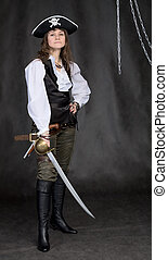The girl - pirate with a sabre in hands on a black ...