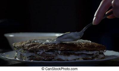 The girl prepares a liver cake, close-up, a dish of liver,...