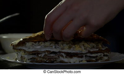 The girl prepares the liver cake and lays the liver cake,...