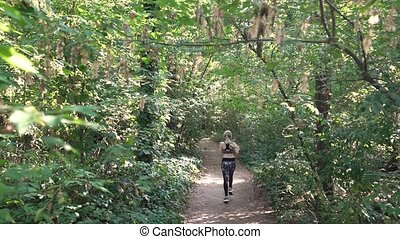 The Girl Runs In Forest