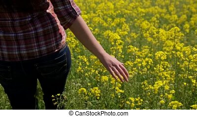 The girl runs on a field of rape