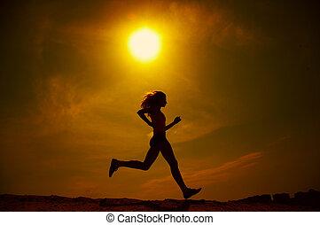 girl runs - The girl runs on sand