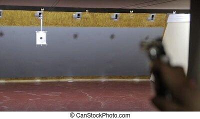 The Girl Shoots A Gun - Blonde girl shoots a revolver gun at...