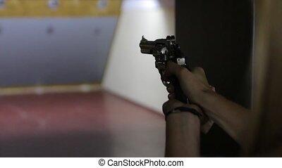 The Girl Shoots Gun - Blonde girl shoots a revolver gun in...