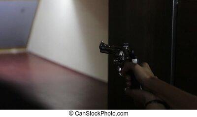The Girl Shoots Revolver Gun - Girl shoots a revolver gun in...
