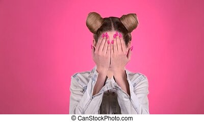 The girl shows a different emotion. Pink background