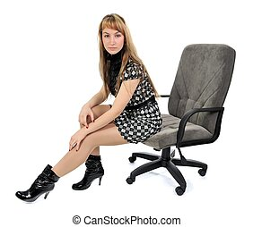 girl sitting in an armchair