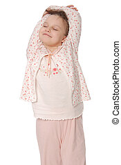 The girl stretches in a sleeping pajamas