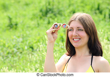 The girl, summer, the field-glass