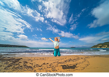 The girl training martial arts on the beach