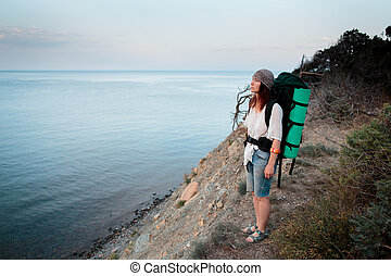 Girl travels to beautiful places on the coast of the sea.