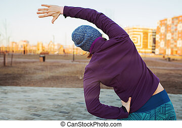 The girl warming up in the morning before jogging. Lead a healthy lifestyle