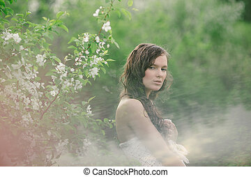 the girl with a bouquet of wild flowers in cloudy weather 2