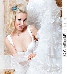 The girl with a wedding dress in hands