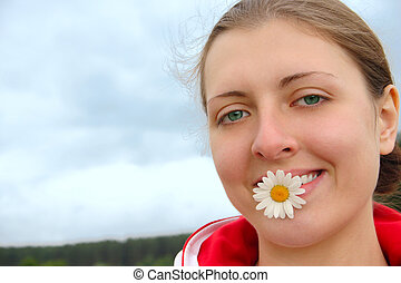 The girl with camomile in teeth