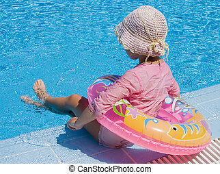 The girl with inflatable circle at pool