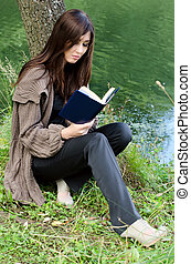 The girl with the book at a pond
