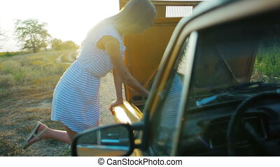 The girl with the faulty car on road
