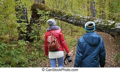 the girl with the guy walking in the autumn Park. Autumn landscape