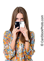 The girl with two mobile phones. Black and white phones