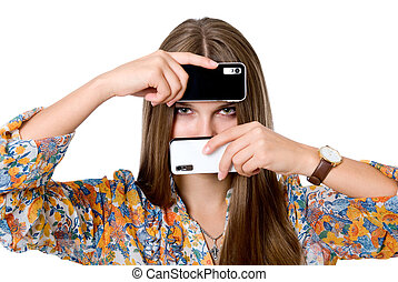 The girl with two mobile phones. Black and white phones.