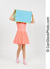The girl wore a box on his head