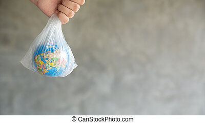 The girl's hand holds the earth in a plastic bag. In the blank for social advertising there is a place for the inscription. The concept of World Environment Day.
