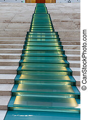 The glass staircase with illumination gone far ahead