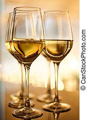The glasses of white wine