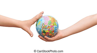 The globe in children's hands.