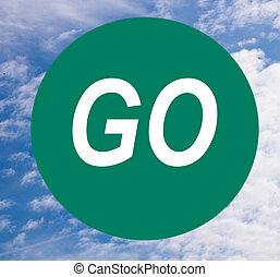 The Go Sign - Green go sign on blue sky. Stop dawdling &...