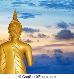 Buddha statue at sunset. Rear view.