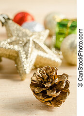The gold cones with christmas decorations.