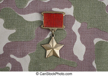 """The Gold Star medal is a special insignia that identifies recipients of the title """"Hero"""" in the Soviet Union on Soviet camouflage uniform"""