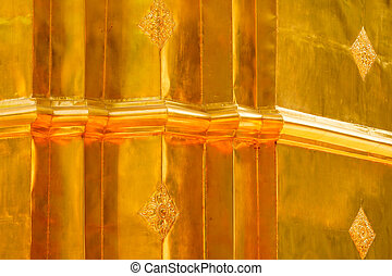The gold stucco design of native thai style on the Wall