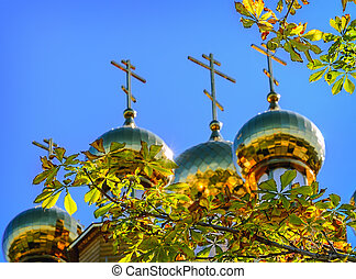 The golden dome on the  wooden russian church