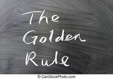 The golden rule words written on the chalkboard
