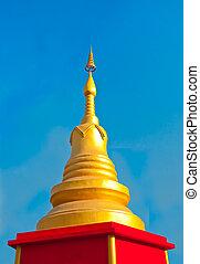 The Golden stupa on blue sky background