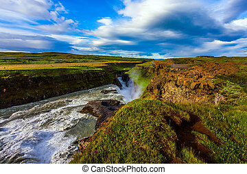 The Golden Waterfall Gullfoss - The falling water of the...