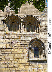 The Gothic windows of the tower of Evora Cathedral. Evora....