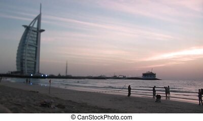 The grand sail shaped Burj al Arab Hotel taken and evening beach in Dubai.