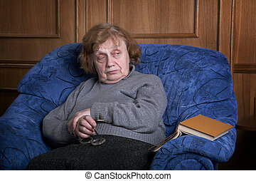 The grandmother in an armchair with the book