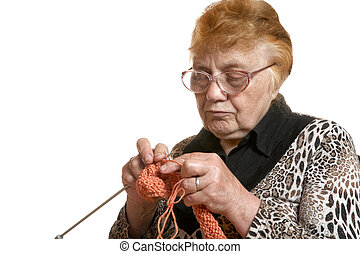 The grandmother knits spokes isolated on a white background