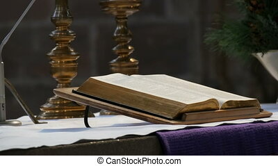 The great book of the priest lies on the altar in the old catholic church