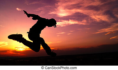 The Great leap - silhouette of a guy taking a great leap...