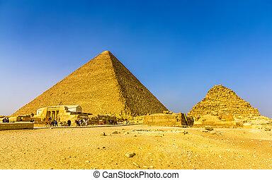 The Great Pyramid of Giza and smaller Pyramid of Henutsen...
