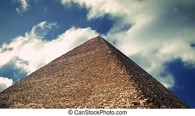 The Great Pyramid of Giza with sunny clouds moving above