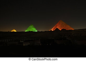 Great Pyramids of Giza in the night laser light during the evening show in Giza. Cairo, Egypt.